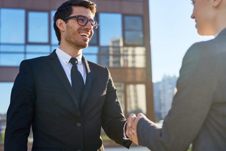 Successful business partners handshaking after negotiation