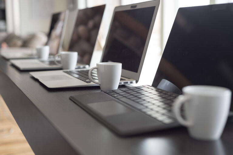 Laptops,And,Espresso,On,Long,Work,Table
