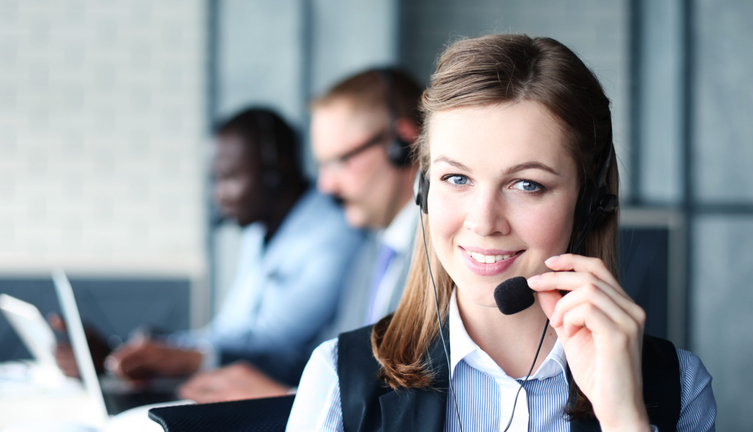 Portrait,Of,Call,Center,Worker,Accompanied,By,Her,Team.,Smiling