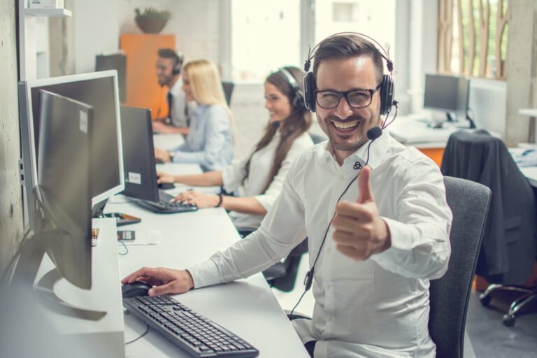 Friendly,Male,Helpline,Operator,Man,With,Headphones,Showing,Thumb,Up